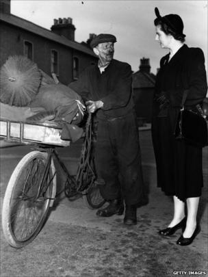 Margaret Thatcher, then known as Margaret Roberts, talks to a chimney sweep while canvassing for votes in Dartford during the 1951 General Election