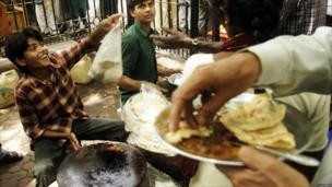 Street vendors serve food in Delhi