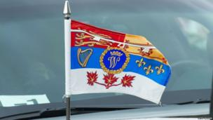 The Duke and Duchess of Cambridge's flag on a car as they visit the National War Memorial in Ottawa, Canada, on the first day of their visit