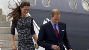 The Duke and Duchess of Cambridge, Prince William and Kate, walk down the stairs of their aircraft upon their arrival in Ottawa, Canada