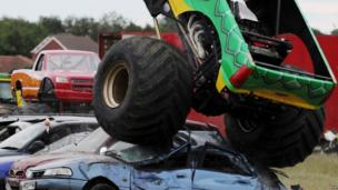 The Monster Truck from The Extreme Stunt Show drives over vehicles at a performance at Earsdon, North Tyneside, during their UK tour.