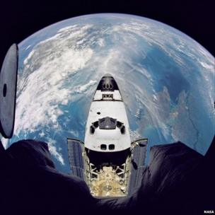 Fish-eye view of the Space Shuttle Atlantis in orbit as seen from the Russian Mir space station during the STS-71 mission