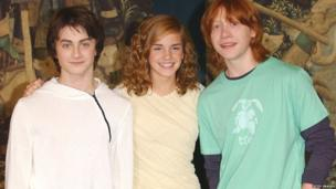 Daniel Radcliffe, Emma Watson and Rupert Grint pose at a photocall ahead of the UK premiere of Harry Potter And The Prisoner Of Azkaban on May 27, 2004 in London