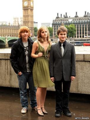 Rupert Grint, Emma Watson and Daniel Radcliffe pose at the photocall for Harry Potter And The Order Of The Phoenix on June 25, 2007 in London, England