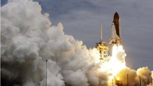 Space shuttle Atlantis lifting off on final space journey