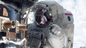 Mike Fossum carries out a space walk at the ISS
