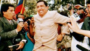 Army Lieutenant Colonel Hugo Chavez, who headed the 1992 attempted coup, talks to reporters 26 March 1994 after he was freed from jail.