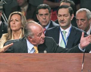 Spanish King Juan Carlo gestures towards Venezuela's President Hugo Chavez, unseen, during a heated verbal exchange.