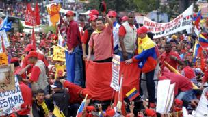 Venezuela's President Hugo Chavez greets his supporters in Caracas, Venezuela, in June 2004