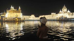 A Sikh man prays outside the Golden Temple in Amritsar, India.