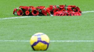 Poppies on football field