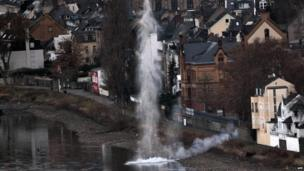 Water sprays from the Rhine River on December 4, 2011 in Koblenz, western Germany, as a bomb disposal team caused a controlled demolition of a tank filled with chemicals