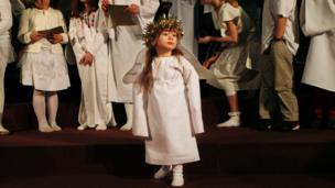 Girl dressed as an angel in a Christmas play