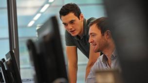 Joe and John by computer monitor