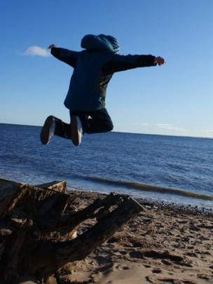 Ethan jumping on the beach