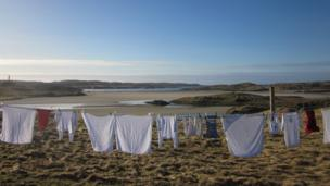 Washing on a clothes line with Uig Bay in the background
