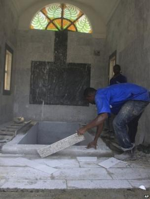 Workers prepare a mausoleum for Chukwuemeka Ojukwu