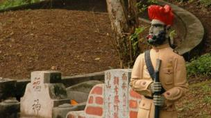 A Sikh guard is one of the features of one of the biggest tombs in Bukit Brown cemetery in Singapore 30 March, 2012