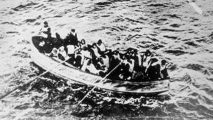 Passengers escaping in a lifeboat