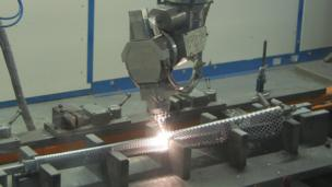 The laser cuts 8,000 circular holes into each torch at a rate of 16 every second