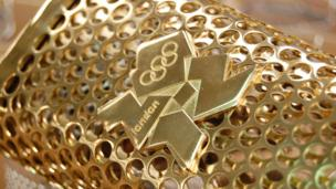 The emblem of the London 2012 Olympics is affixed to the front of the torch
