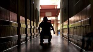 Anibal Rodriguez De Souza, 73, wheels his way down the hallway at the Antonio Aleixo leprosarium on 17 March 2012 in Manaus.