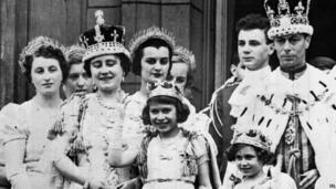 Queen Elizabeth (later the Queen Mother), Princess Elizabeth (the present Queen Elizabeth II), Princess Margaret and King George VI after his coronation, on the balcony of Buckingham Palace, London.