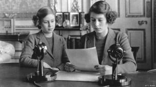 Princesses Elizabeth (right) and Margaret (1930 - 2002) making a broadcast to the children of the Empire during World War II.