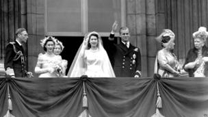 Britain's Queen Elizabeth II, then Princess Elizabeth, and her husband Prince Philip, the Duke of Edinburgh, wave to the crowd from the balcony of Buckingham Palace, London, in this Nov. 20, 1947 file photo, after their wedding. From left to right, King George VI, Princess Margaret, Lady Mary Cambridge, the bride and bridegroom, Queen Elizabeth and Queen Mary.
