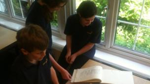 School Reporters looking at archives