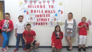 Buile Hill Visual Arts College jubilee street party banner with students