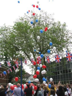 Pupils from Blackheath High School release red, white and blue balloons