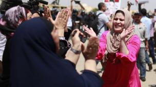 Egyptians celebrate outside the police academy where deposed Egyptian President Hosni Mubarak is on trial in Cairo