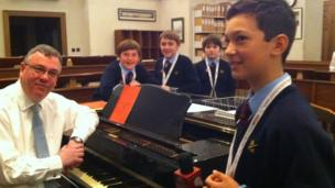 School Reporters and choristers from St Paul's Cathedral School with Musical Director Andrew Carwood