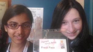 School Reporters proudly holding up their press pass
