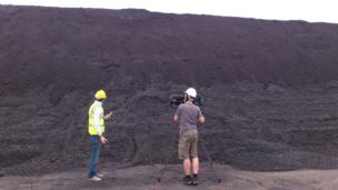 Joe in front of a coal mountain at Didcot Power Station.