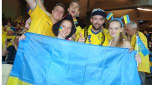Ukraine students hold up their flag for Euro 2012