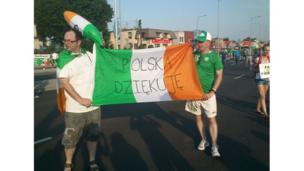 Ireland fans hold up a sign saying