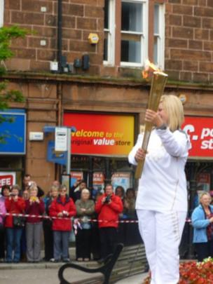 Woman carrying the Olympic torch