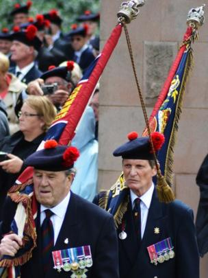 Men hold the colours of the Black Watch