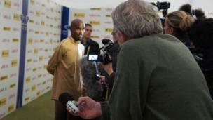 Mo Farah answers questions in the mixed zone