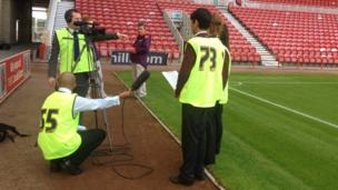 Jordan, Trib and Harriet giving report from pitchside at the Riverside Stadium