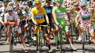 Tejay Van Garderen of the USA and BMC Racing, white jersey winner, Bradley Wiggins of Great Britain and SKY Procycling, yellow jersey winner, Peter Sagan of Slovakia and Liquigas-Cannondale and Thomas Voeckler of France and Team Europcar, polka dot jersey winner pose on the start line ahead of the twentieth and final stage of the 2012 Tour de France, from Rambouillet to the Champs-Elysees on July 22, 2012 in Paris, France.