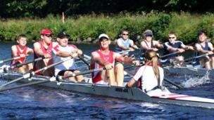 Teams of rowers racing in the water