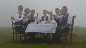 Men sitting at a dinner table on the Quiraing