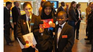 School Reporters Emily and Laki with Jubilee Time Capsule guest John, 12 from Malawi
