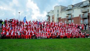 People dressed as Santa