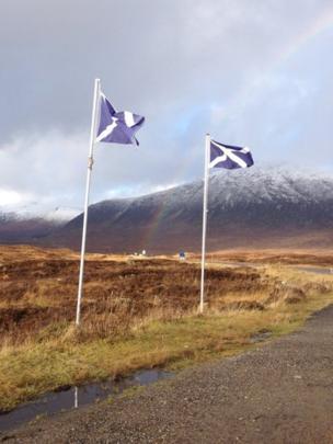 Rainbow and saltire flags in Glencoe