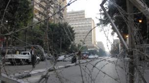 Barbed wire blocking Qasr al-Aini Street