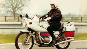 Police officers on a motorbike in the 1970s
